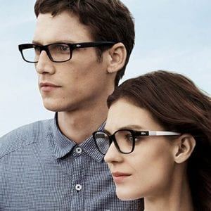 Couple wearing Lacoste Glasses