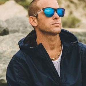 Surfer man wearing Oakley Glasses