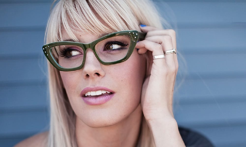 FRIEZE glasses being worn by blonde woman