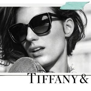 A woman wearing Tiffany and co glasses