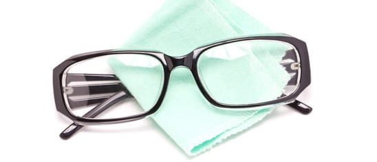 photodune-5167221-eye-glasses-with-cleaning-cloth-isolated-on-white-background-xs