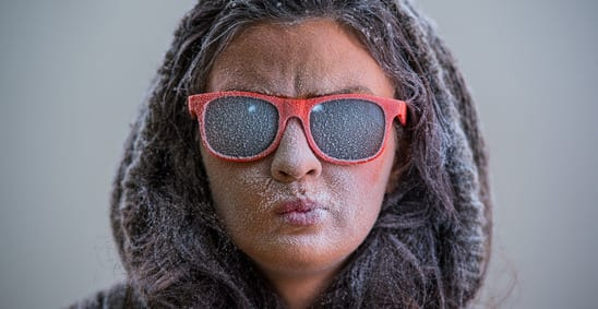 Woman wearing sunglasses during the winter.